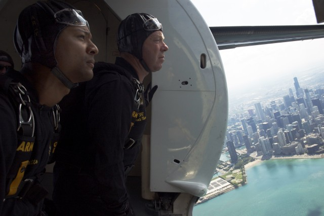 Staff Sgt. Noah Watts and Sgt. 1st Class Harold Meyer, U.S. Army Golden Knights Parachute Demonstration Team, locate their target on Chicago's North Avenue Beach for their performance at the 50th Annual Air and Water show, Aug. 17, 2008.