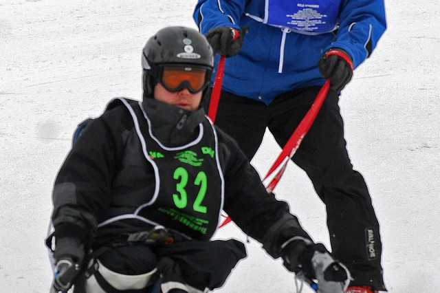 Joey Bozik (wearing bib 32), a four-time National Disabled Winter Sports Clinic participant, is a triple amputee who looks forward to skiing and using a bi-ski every year.