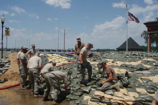 Soldiers from the Missouri National Guard's 1138th Transportation Company reinforce the main wall during spring floods along the Mississippi River in downtown Clarksville, Mo.