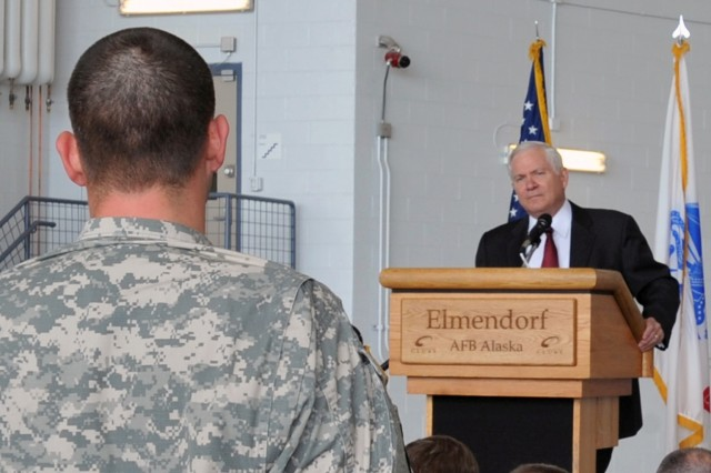 U.S. Defense Secretary Robert Gates answers questions  from Army and Air Force troops during a town hall meeting as part of his tour of  Elmendorf Air Force Base, near Fort Richardson. Secretary Gates, joined by U.S. Sen. Mark Begich, D-Alaska, also visited Fort Greely to tour the facility's missile defense site. Gates stopped in Alaska on a return trip from Asia. (U.S. Air Force photo by Senior Airman Laura Turner)