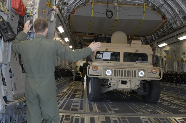 A members of the C-17 aircrew load Deployable Assessment Team vehicles in preparation for deployment to Kauai May 30 at Hickam Air Force Base.