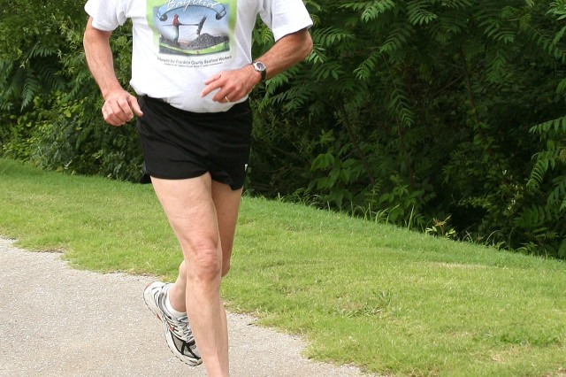 Robert McMillan, senior scientist at U.S. Army Space and Missile Defense Command/Army Forces Strategic Command, begins his 3.5 mile run Friday. McMillan, 74, continues to run, bike and lift weights to stay in shape and remain healthy.