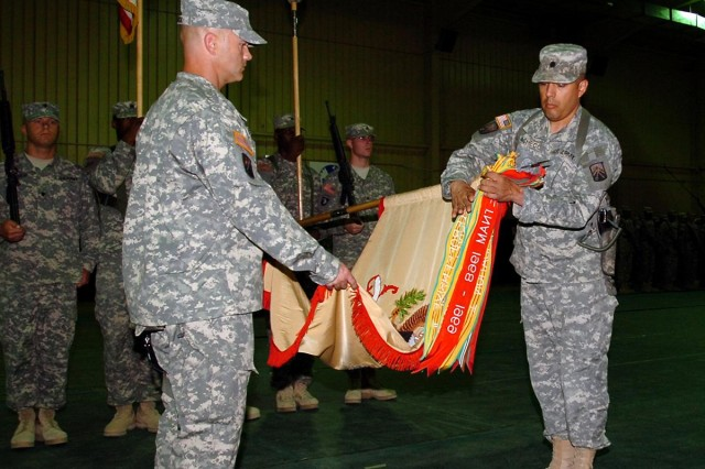 Lt. Col. Ronald E. Pacheco Jr., 391st Combat Sustainment Support Battalion commander, and Command Sgt. Maj. David C. Emerick, 391st CSSB senior enlisted leader, case the 391st CSSB colors as they transfer authority to the 264th CSSB during a ceremony at Contingency Operating Base Speicher, Iraq, May 25. The 391st CSSB from Bamberg, Germany, shipped 27,165 pallets, 2,773 containers and 6,784 pieces of Class VII materials during their deployment in support Operation Iraqi Freedom.