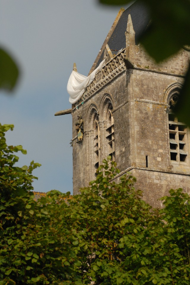 Church tower, windows pay tribute to paratroopers who jumped into first town liberated during World War II