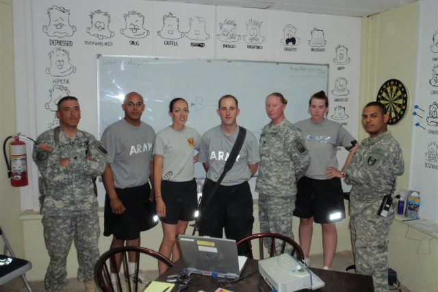 Left to right: First Sgt. Moises Gonzales, Spc. Angel Rosa, Sgt. Michelle Sanchez, Pfc. Eric Prox, Spc. Christina Warren, and Pfc. Christine Wells from Headquarter and Headquarters Company, 18th Combat Sustainment Support Battalion, 16th Sustainment Brigade, received a smoking cessation class from Sgt. James Movick of the 528th Combat Stress Control Team at COS Marez-East, Iraq May 9.