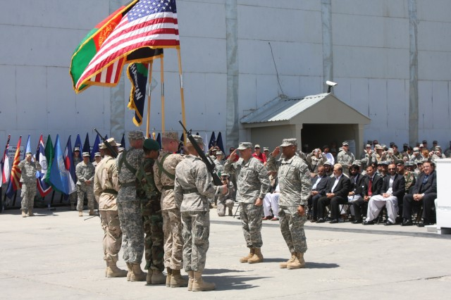 Maj. Gen. Curtis M. Scaparrotti, commander of the 82nd Airborne Division and Combined Joint Task Force 82, and Command Sgt. Maj. Thomas Capel, command sergeant major of both organizations, salute the American, Afghan and CJTF 82 colors during a transfer-of-authority ceremony at Bagram Airfield, Afghanistan, June 3, 2009.
