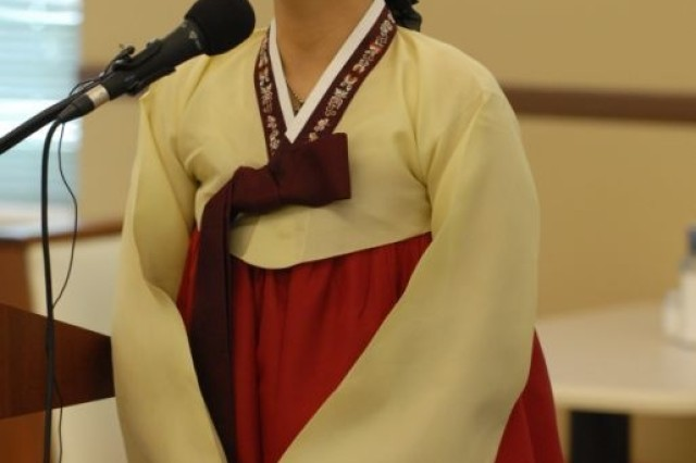 Jae Jeon, the wife of 1/5th Inf. Chaplain Capt. Philip Jeon, sings a Christian hymn in traditional Korean garb at the 3rd HBCT's Asian Pacific Heritage Month luncheon held at the Kelley Hill Dining Facility on Fort Benning, Ga., May 27. Chaplain Jeon was the featured speaker at the event.