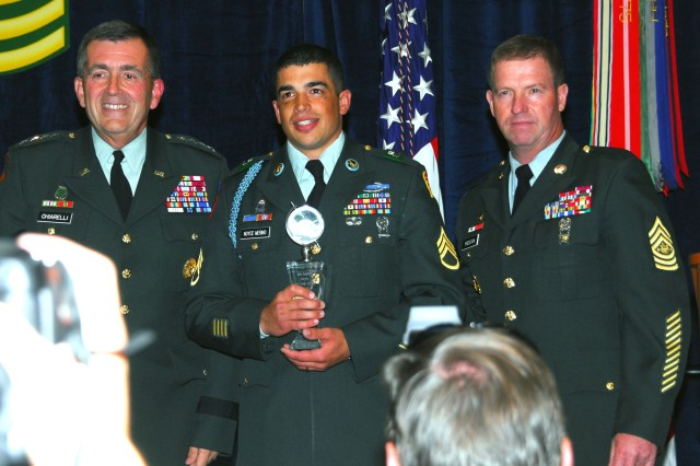 Vice Chief of Staff of the Army Gen. Peter W. Chiarelli, Staff Sgt. Michael Noyce Merino and Sgt. Maj. of the Army Kenneth O. Preston were on stage Oct. 6 at the 2008 Association of the U.S. Army annual meeting and exposition to announce the 2008 Army Best Warriors. Noyce Merino was named the Army's NCO of the Year for 2008.