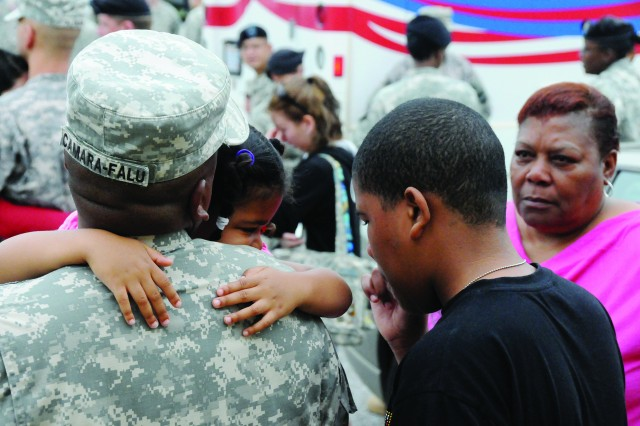Sgt. 1st Class Jorge Camara-Falu comforts his 5-year-old daughter, Amber, as he prepares to deploy.
