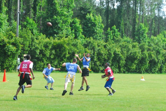 Rivals from Batteries A and B, 1/76 FA, 4th IBCT, go head to head in a game of flag football during the battalion's Organizational Day at J.F. Gregory Park, May 29.