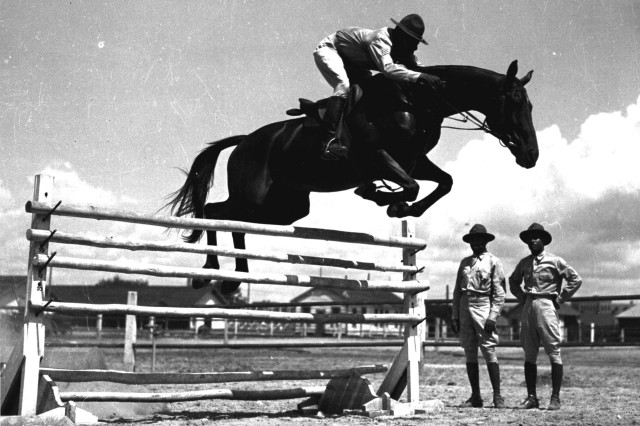 "Sgt. John Hill, an African American ""Buffalo Soldier"" at Fort Benning, Ga., July 25, 1941, rides Jumping Dan Ware, considered the finest jumping horse in the infantry."