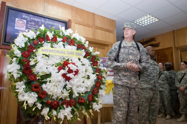 Brig. Gen. Michael J. Lally, 3d Sustainment Command Expeditionary commanding general and Command Sgt. Maj. Willie C. Tennant, 3d ESC Command Sergeant Major, laid a wreath to remember nine 3d ESC Soldiers who died while in support of Operation Iraqi Freedom during a Memorial Day ceremony at the 3d ESC Headquarters, Joint Base Balad, Iraq, May 25.