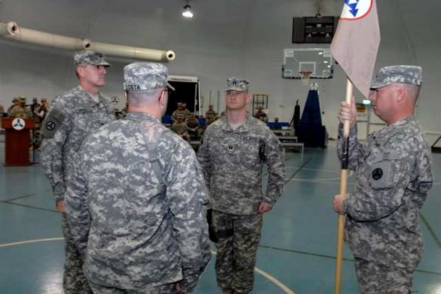 From left to right: Col. Marvin S. Whitaker, the chief of staff, 3d Sustainment Command (Expeditionary); Capt. Brian D. Costa; Capt. Brian W. Pilch; and 1st Sgt. Jeffery W. Burnsworth prepare to conduct a change of command during a ceremony at Joint Base Balad, Iraq May 22. Pilch assumed command of Headquarters and Headquarters Company, 3d ESC, from Costa