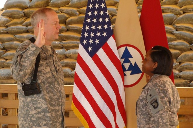 Staff Sgt. Amethia Stevenson repeats the Oath of Re-enlistment by Brig. Gen. Michael J. Lally, commanding general, 3d Sustainment Command Expeditionary during a re-enlistment ceremony at Joint Base Balad, April 22. Stevenson, member of the 233rd Transportation Co., 391st Combat Sustainment Support Battalion, 16th Sustainment Brigade and is a native of Hopkinsville, Ky., she requested the commanding general to conduct the Oath of Re-enlistment, and this is her fourth.