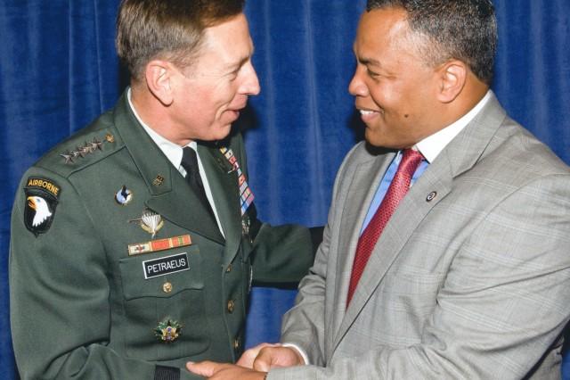 "Gen. David Petraeus and Mark ""Ranger"" Jones meet in Washington during an awards ceremony."