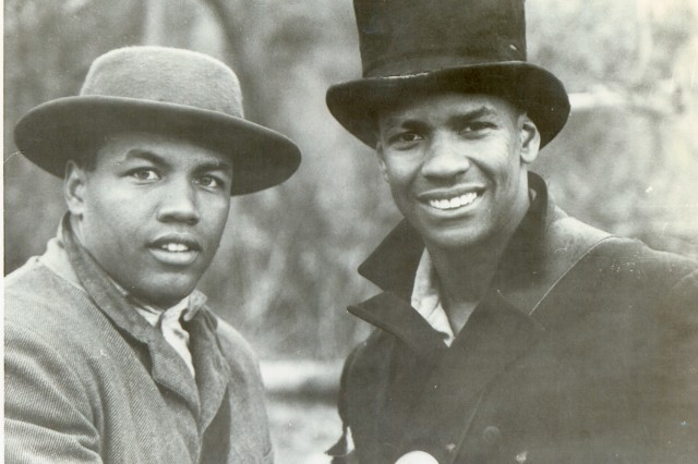 "Mark ""Ranger"" Jones and actor Denzel Washington pose in period costume on the set of ""Glory."""