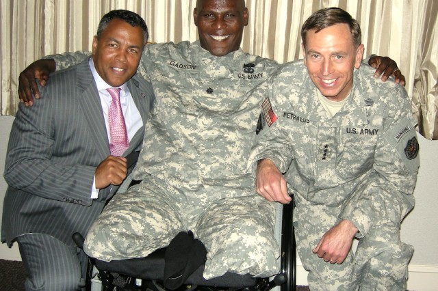 "Mark ""Ranger"" Jones and Gen. David Petraeus visit Lt. Col. Greg Gadson at Walter Reed Army Medical Center in Washington during a luncheon for wounded Soldiers. Gadson, who is now back on active duty, was the New York Giants' guest at Superbowl XLII in 2008."