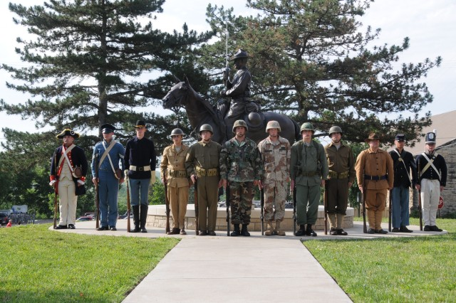 Soldiers representing the Army throughout the ages line up outside of the U.S. Cavalry Museum during the 2008 Army birthday celebration at Fort Riley.