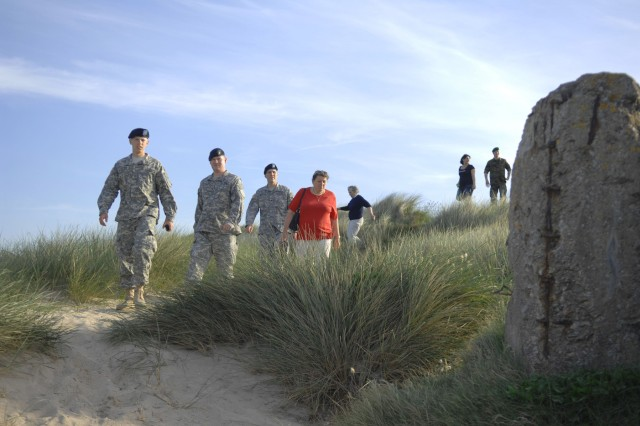 Saint-Martin-sur-Varreville (France) Mayor Jeua Le Barhershaun (center) leads 1st Infantry Division Soldiers on a tour of historic sites on Utah Beach June 3 before the Soldiers joined the town's residents for a dinner to which the troops were invited as a gesture of gratitude for the allied liberation of France in World War II.