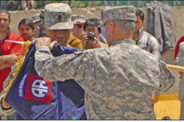 Maj. Gen. Curtis M. Scaparrotti, commander of the 82nd Airborne Divison and Combined Joint Task Force¬82, and Command Sergeant Major Thomas Capel, command sergeant major of the 82nd Abn. Div. and CJTF-82, uncase the CJTF-82 colors during a transfer of authority ceremony at Bagram Airfield, Afghanistan Wednesday. CJTF-82 and the 82nd Abn. Div. assumed command of RC-East from CJTF-101 and the 101st Abn. Div. (Air Assault).