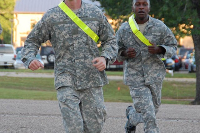 Sgt. Kevin Pease (left) and Spc. Ewen Tesot compete in Fort Polk's U.S. Army Medical Department Activity's leadership and training competition May 29. The pair finished second in the event.