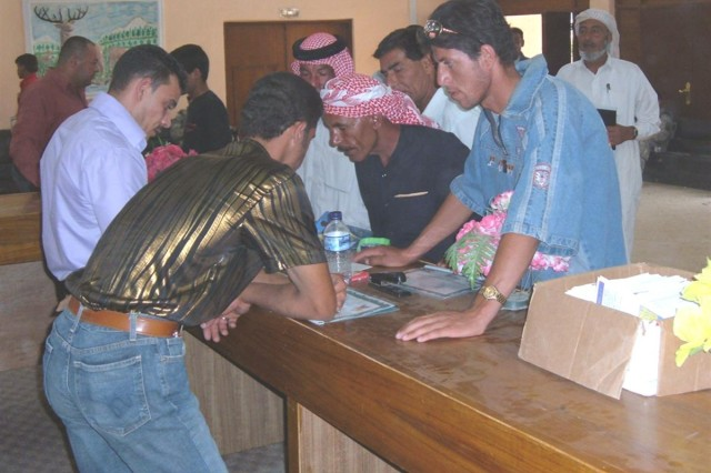 Civil Service Corps program graduates line up to register for employment at the Balad, Iraq municipal offices
