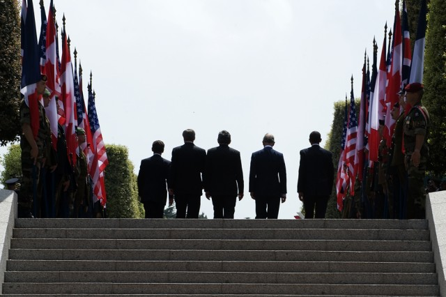 At the start of the D-Day 65th commemoration ceremony, world leaders prepare to step onto the stage at the Normandy American Ceremony in France.