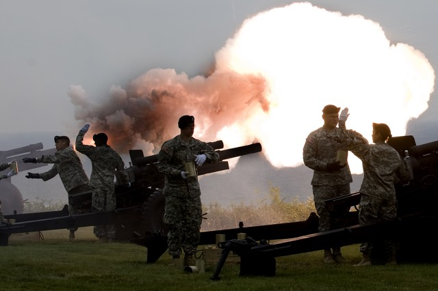 The U.S. Army Salute Battery Team, 529th Military Police Company, U.S. Army Garrison Heidelberg, Germany, fires the ceremonial M1A1 howitzer overlooking Omaha Beach at the Normandy American Cemetery, France.