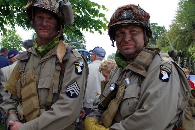 """D-Day enthusiasts from England suit up in full vintage U.S. Army uniforms from the second World War at a ceremony commemorating veterans at the Airborne museum here, June 6. """""""