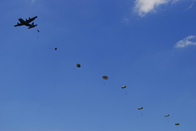 """Army Reserve paratroopers jump from British aircraft using British gear to earn their British parachute wings here, June 30, as part of a joint-training exercise called Operation Air Drop Warrior. The operation was an Army Reserve mission designed to foster training and camaraderie between the British """"Paras"""" and Army Reserve paratroopers, and to support airborne operations commemorating the 65th D-Day Anniversary ceremonies, June 6. The U.S. Army Civil Affairs and Psychological Operations Command (Airborne) is the sole airborne command within the U.S. Army Reserve. """""""