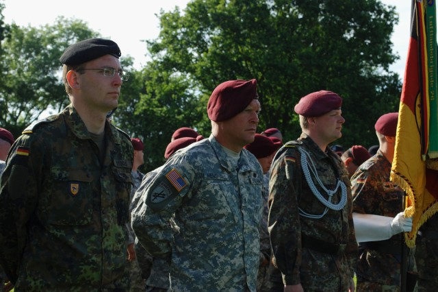 """German and America Soldiers stand side-by-side, and were joined by over 30 German, American, British and French WWII veterans, to honor the fallen and commit to a partnership for peace here on June 5. Over 200 people attended the commemoration service. """""""
