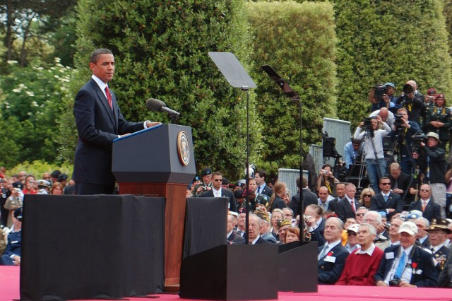 U.S. President Barack Obama addresses the crowd and highlights the legacy entrusted to us by the WWII combat veterans that surround him here on June 6. The president was in Normandy to attend the 65th Anniversary of the D-Day landings at