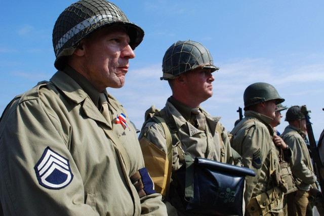 """D-Day enthusiasts from France suit up in full vintage U.S. Army uniforms from the World War II at a ceremony commemorating veterans of Omaha Beach, June 4. """""""