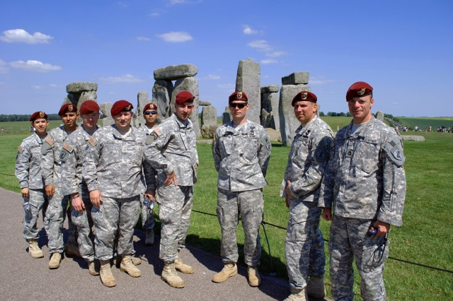 """U.S. Army Reserve Soldiers with the U.S. Army Civil Affairs and Psychological Operations Command (Airborne), headquartered at Fort Bragg, N.C., pose in from of legendary Stonehenge. The Soldiers come from various units within USACAPOC(A), which has warrior citizens in 31 states and one territory (Puerto Rico). The Soldiers are in Europe conducting training and supporting Operation Air Drop Warrior, an Army Reserve Airborne mission supporting the 65th D-Day Anniversary ceremonies. """""""