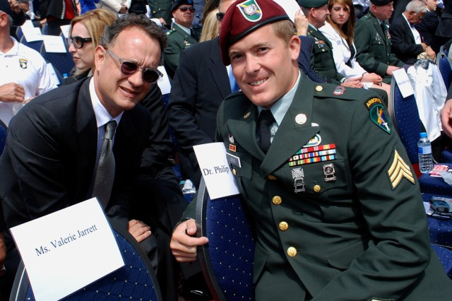 """Actor Tom Hanks takes time out to pose with Army Reserve Sgt. Mark T. Leng at the 65th D-Day Anniversary ceremonies in Colleville Sur-Mer on June 6. Leng, who hails from Lexington, Ky., is assigned to the U.S. Army Civil Affairs and Psychological Operations Command (Airborne), located at Fort Bragg, N.C. """""""