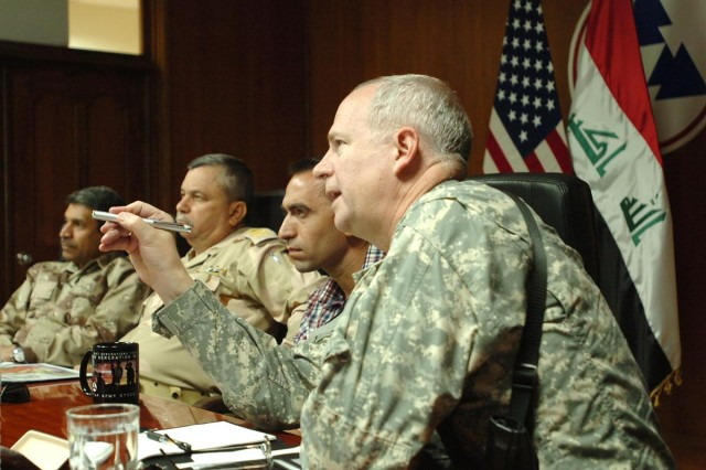 Brig. Gen. Michael J. Lally, 3d Sustainment Command (Expeditionary) commanding general, points out a few key points maintenance management to Staff Maj. Gen. Muniem and Brig. Gen. Nabeel during a briefing at the 3d ESC headquarters at Joint Base Balad, Iraq, June 2. Muniem and Nabeel visited JBB and the 3d ESC to exchange knowledge on maintenance management and repair processes.
