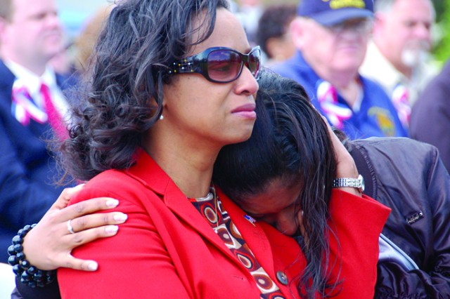"""Lisa Chase comforts her daughter, Symone, during the playing of  """"Wind Beneath My Wings"""" at the Change of Responsibility Ceremony held April 22."""