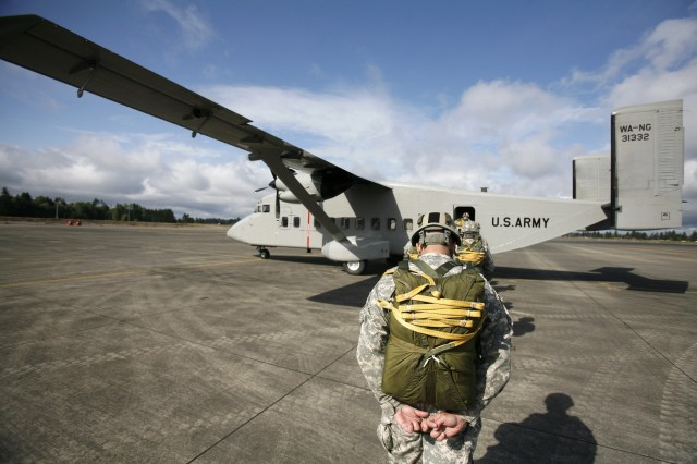 Soldiers from 38th LRS Co. board a C-23 Sherpa at Gray Army Airfield before a company jump.