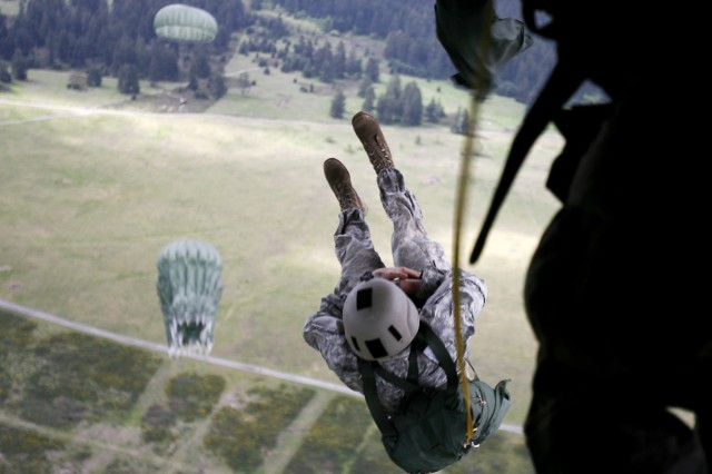 LRS Soldiers jump onto Rogers Drop Zone from a C-23 Sherpa.