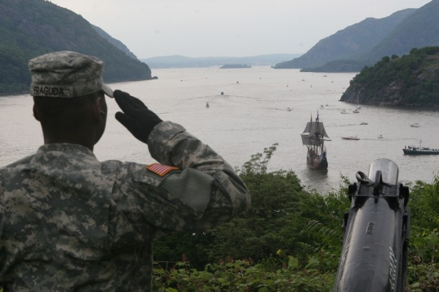 Spc. Frankie Fraguda, West Point Military Police Co., salutes the Half Moon as it sails past West Point on Sunday, June 7, 2009.  The Half Moon, a replica of the ship Henry Hudson sailed up the river in 1609 on his exploration, led a procession of ships re-tracing Hudson's route up the river that bears his name.  West Point rendered a 15-gun salute from Trophy Point before the crew of the ship returned the favor.