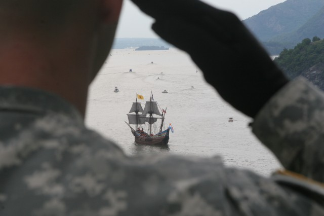 The Half Moon is seen through the salute of a West Point Military Policeman on Sunday, June 7, 2009, as it passes West Point.  The Half Moon led a procession of ships north from New York City as it re-created Henry Hudson's trip up the river that now bears his name.  The salute battery fired a 15-gun salute from Trophy Point.