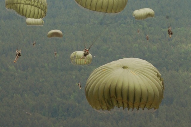 Soldiers from the U.S. Army Civil Affairs and Psychological Operations Command (Airborne) at Fort Bragg, N.C., float toward Sicily Drop Zone, D-Day 2009.