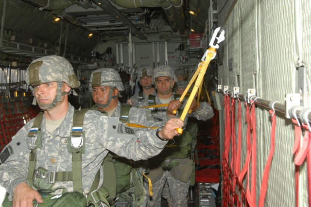 """Soldiers assigned to the 28th Combat Support Hospital, Fort Bragg, N.C., are """"hooked up"""" and awaiting the jumpmaster signal to exit the aircraft during an airborne operation at Sicily Drop Zone. Approximately 60 Soldiers participated in the jump that took place D-Day, 2009."""