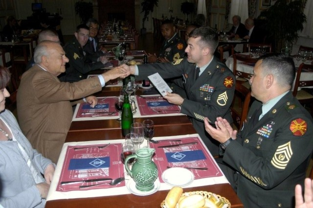 Brussels NCO Attains Education Milestone