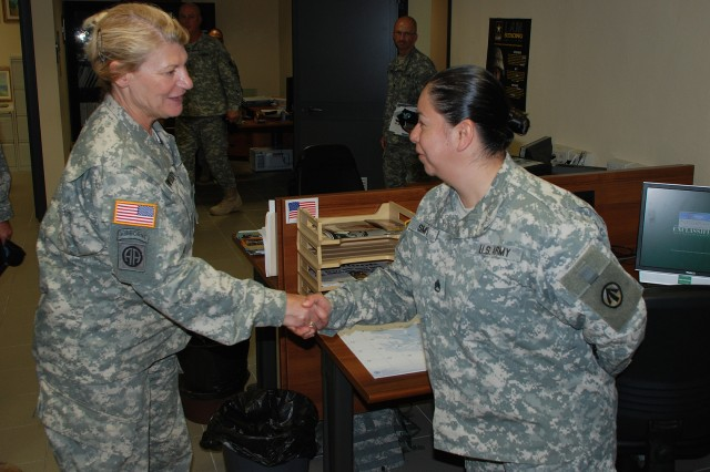 Gen. Ann E. Dunwoody, commanding general, U.S. Army Materiel Command, thanks Staff Sgt. Nadia Smith, a movement NCO for 839th Transportation Battalion, for her hard work overseeing different types of cargo offloads and uploads at Livorno, Italy, port.