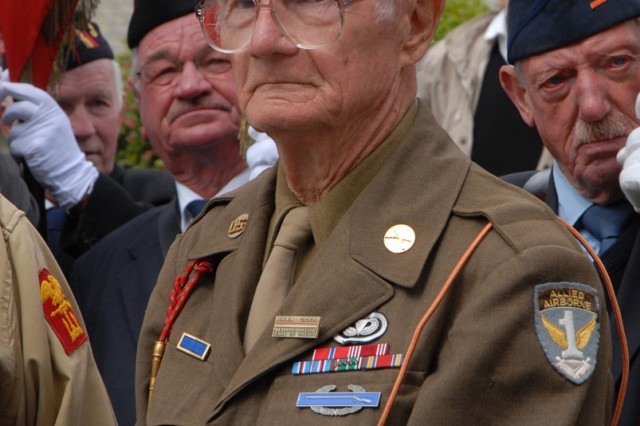 William Tritt, 86, a native of Carlisle, Penn., wears his original uniform from World War II at a ceremony in honor of D-Day veterans outside the town hall of Sainte Mere Eglise, France, June 7.