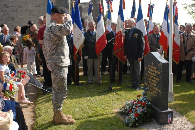Brig. Gen. Jon Miller, deputy commanding general of the 21st Theater Sustainment Command, salutes after laying a wreath at the base of a memorial in Hemevez, France June 5 to seven paratroopers who were executed on D-Day by German troops. The ceremony was one of dozens of events in the Normandy region commemorating the 65th anniversary of the Normandy invasion.