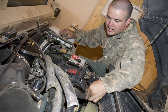 Spc. Kevin P. Lawson, a mechanic with the inspections team, 602nd Maintenance Company and resident of Alamogordo, N.M., inspects a humvee engine at Joint Base Balad, Iraq, May 16. Some members of the 602nd Maintenance Company are responsible for fixing humvees that are shipped to Camp Taji, Iraq, and sold to Iraqi government.