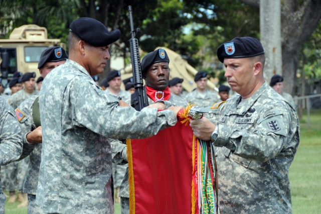 Col. Fabian Mendoza, left, and Command Sgt. Maj. Dale Moran case the brigade colors during a deployment ceremony June 4 on Hamilton Field, Schofield Barracks, Hawaii. Soldiers of the brigade depart during the next few weeks for a 12-month deployment to Iraq.