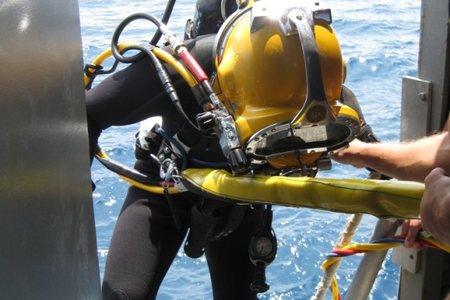 A diver from the 7th Engineer Dive Detachment prepares to enter the water during Operation Deep Blue off the big island of Hawaii. The dive recertification exercise ran May 11 through May 22.